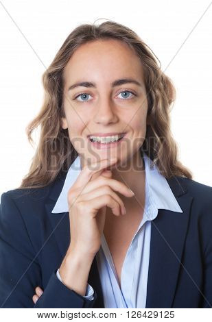 Portrait of a blond businesswoman with blue eyes and blazer on an isolated white background for cut out