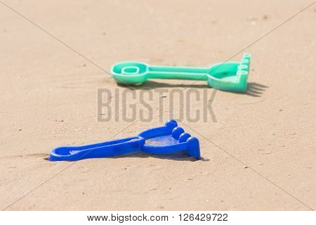 Childrens Toy Rake Lying On The Sand
