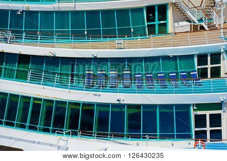 Side of a cruise ship with balcony in natural light