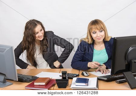 Office Worker With Feigned Indignation Looking At The Colleague Sitting Next To The Computer Innocen