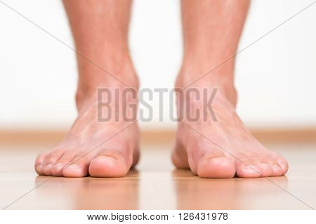 Man feet close-up, health feet at home