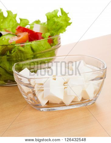 Picture of plates with greek salad and feta on table