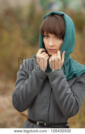 Beautiful stylish woman in grey coat outdoors