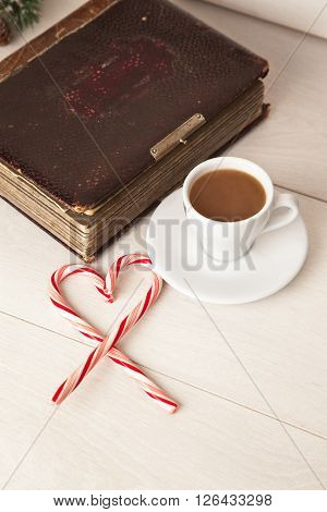 Picture of morning cup of coffee album and candy cane