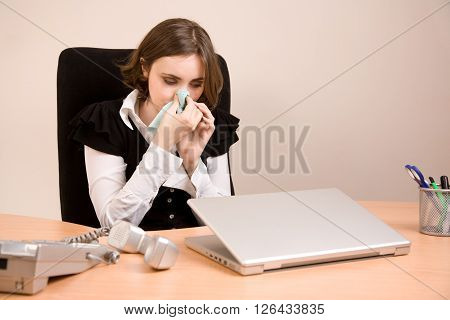 Picture of young businesswoman crying at office