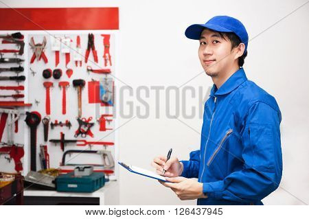 Young Male Engineer At Work In Mechanic Tools Storage Room