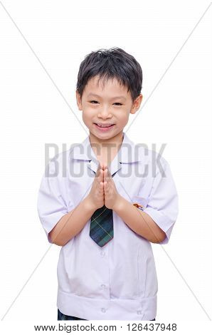 Young asian schoolboy doing gesture welcome over white