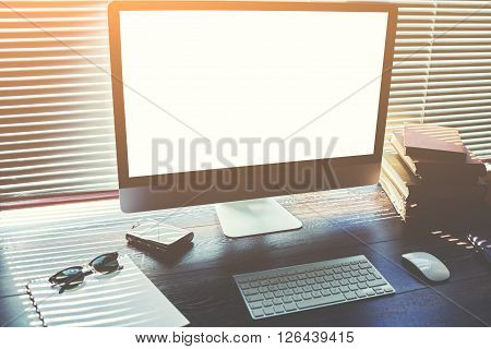 Mock up of home desktop with accessories and work tools pc computer with blank copy space screen for your content keyboard with mouse sunglasses books and notepad modern office work space