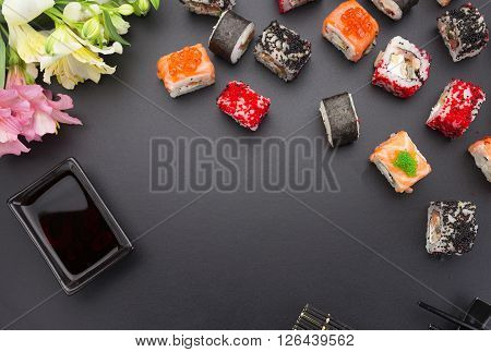 Japanese Cuisine. Set Of Sushi Mix Roll With Differen Fresh Ingredients Over Black Background ( Tabl