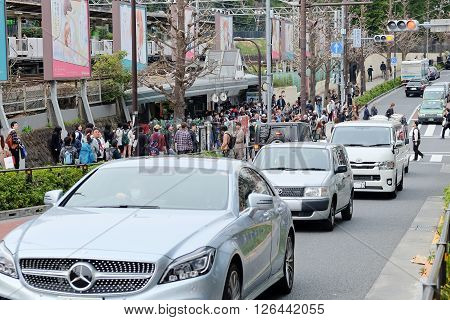 TOKYO, JAPAN - MARCH 30 2016: Traffic jam on the main crossroad of Harajuku shopping street on MARCH 30, 2016 in Tokyo, Harajuku is known as a center of Japanese youth culture and fashion.