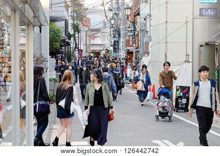 Tokyo, Japan - March 30, 2016 : Tourists and business people in Ura-Harajuku street,Harajuku is known as a center of Japanese youth culture and fashion.
