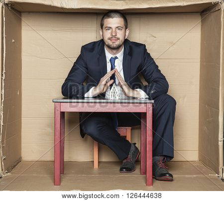 young handsome business man siting in his box office