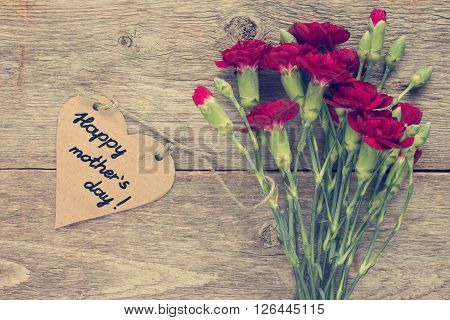 Heart shaped mothers day card with carnations bouquet