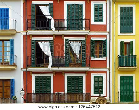 colorful vintage mediterranean urban house fronts in Palma Majorca Balearic Islands Spain