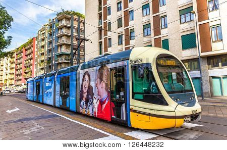 Milan, Italy - May 8, 2014: AnsaldoBreda Sirio tram in the city centre of Milan. In operation since 1881, the tram network is now 170 kilometers long