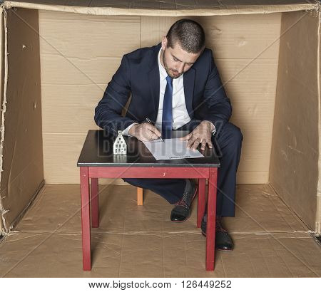 Businessman Signs A Contract Insurance On The House