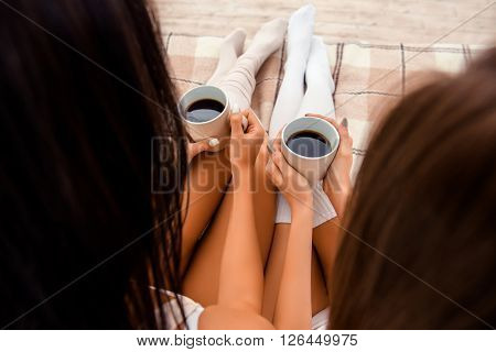 Close Up Photo Of Two Cups Of Coffee In Hands, Top View Point