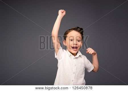 Yes!  Happy Little Boy Triumphing With Raised Hands
