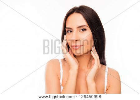Calm Pretty Woman Touching Her Face On White Background