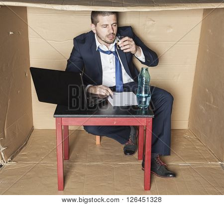 Drunk Businessman Sitting In The Office