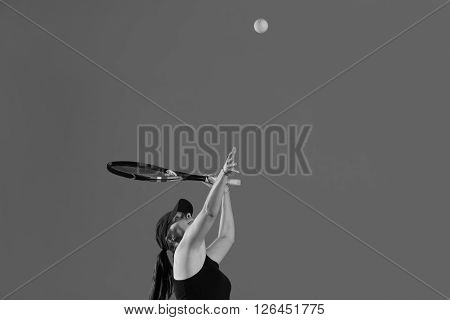 Young Tennis Player Hitting A Ball