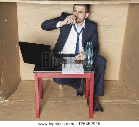 Businessman Drinking Alcohol During Working Hours