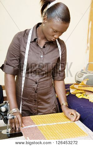 Seamstress checks the measurements of its pieces of fabric. ** Note: Soft Focus at 100%, best at smaller sizes