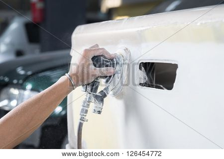 Auto body repair series : Closeup of hand sanding car paint