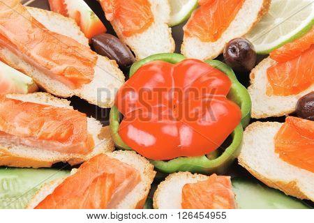 fresh vegetables with salmon on dark dish