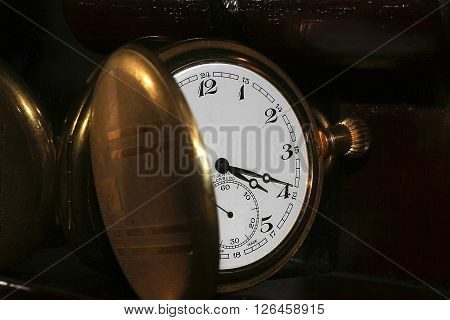 old clock with brass cover, macro photo