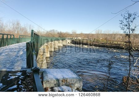 Icy footbridge crosses Blackstone River Bikeway in Lincoln Rhode Island