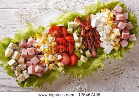 Tasty American Cobb Salad Close-up On A Plate On The Table. Horizontal Top View