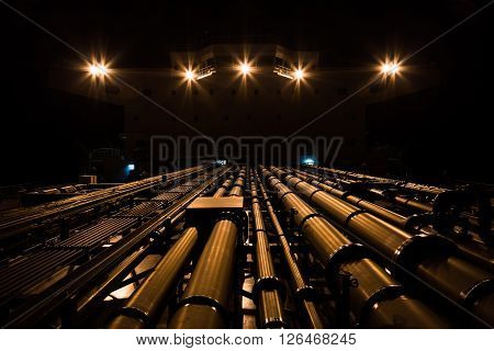 Tanker pipeline and superstructure at night - view from fore to aft.