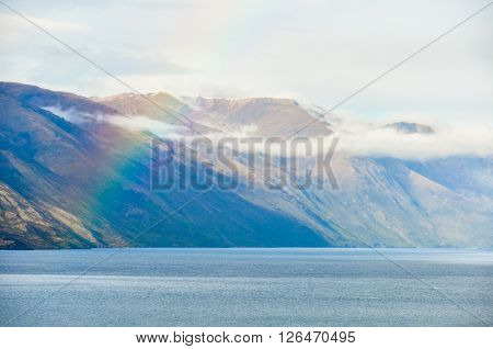 Rainbow Over A Lake In Southern Lakes, New Zealand