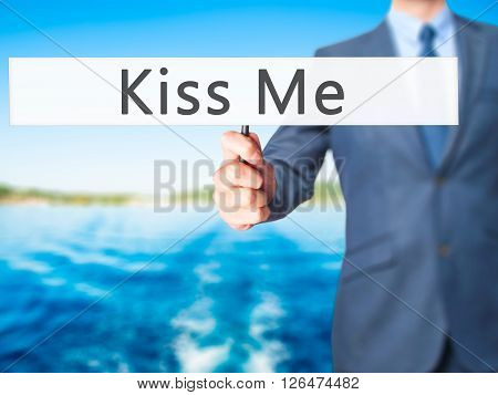 Kiss Me - Businessman Hand Holding Sign