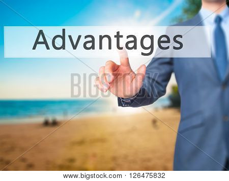 Advantages - Businessman Hand Pressing Button On Touch Screen Interface.