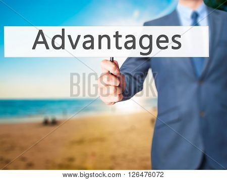 Advantages - Businessman Hand Holding Sign