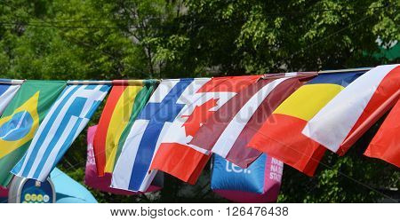 The flags of Brazil Greece Chad Canada Mali Finland and Latvia
