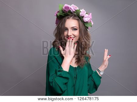 Young lovely woman smiling and having good time wearing a nice flower circlet.