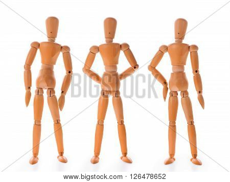Wooden dummies in three different poses isolated on white background