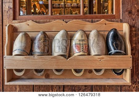 Typical wooden dutch clogs on the stand in Zaanse Schans, Netherlands.