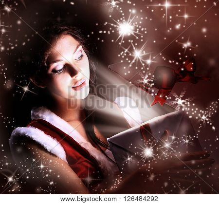 santa woman opening the magical Christmas present box