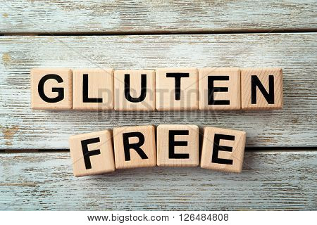Gluten-free diet concept. Cubes on wooden background