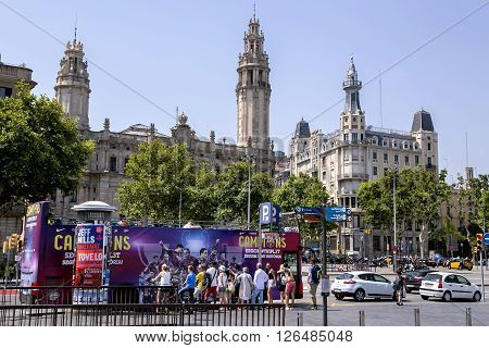 SPAIN, BARCELONA, JUNE, 27, 2015 -A group of tourists traveling on Sightseeing Hop on Hop off bus in Barcelona, Catalonia, Spain. Tourist bus is a popular transport for tourists in Barcelona.