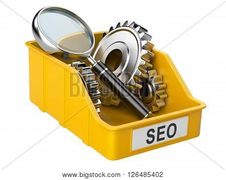 Box with gears inside and magnifying glass. SEO concept related to the ideas and technologies.