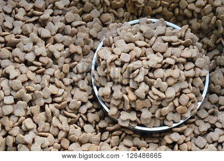 pet food on stainless bowl in sack bag