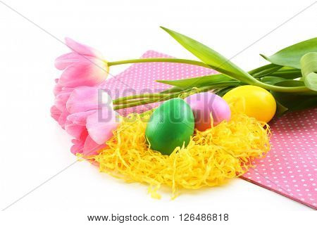 Multicoloured Easter eggs and tulips on napkin isolated on white