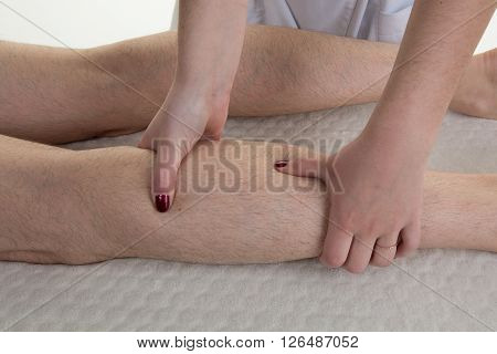 Masseur Giving Legs  Massage To A Woman At Spa Salon