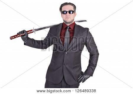 Handsome man holding katana sword. Isolated on white background.