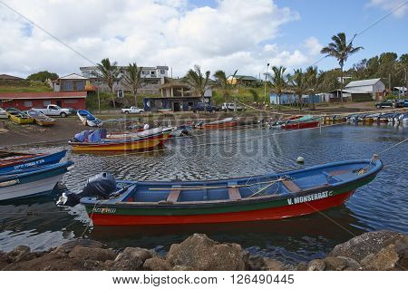 HANGA ROA, EASTER ISLAND, CHILE - APRIL 6, 2016: Fishing boats in a small harbour in HANGA ROA, capital of Easter Island.